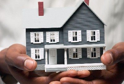 A house held in hands